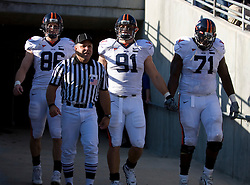 Virginia Cavaliers captains Tom Santi, Chris Long, and Branden Albert enter the field.   The North Carolina State Wolfpack defeated the #15 Virginia Cavaliers 29-24 at Carter Finley Stadium in Raleigh, NC on October 27, 2007.