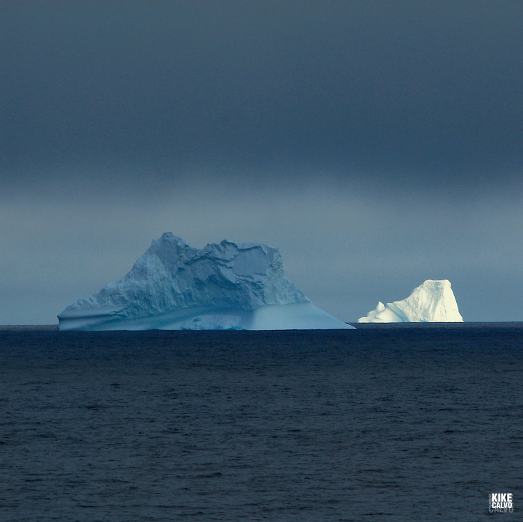 Icebergs from Greenland, drifting on Iceberg Alley. Baffin Bay.  Baffin Island. High Arctic. Canada.( environment, global warming, ice, snow, white, blue, turquoise, inmense, mass, block, glacier, foggy, fog, ocean, arctic circle, winderness, view, trip, exploration, wild, scenic, scenics, seascape, tourist, cold