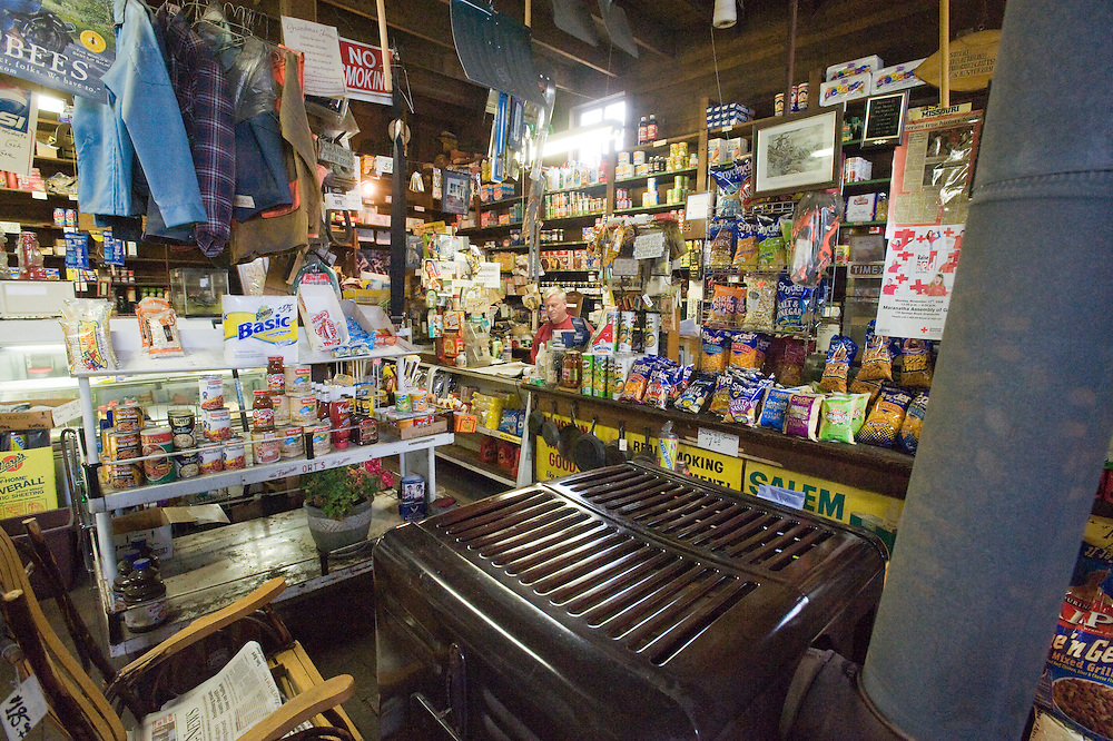Shop owner at the register in old time convenient store