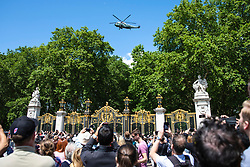 © Licensed to London News Pictures. 03/06/2019. London, UK. Members of the public take pictures of Marine One as it carries President of the United States Donald Trump to Buckingham Palace. President Trump is in the UK for a three-day State Visit. Photo credit: Rob Pinney/LNP