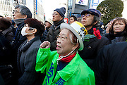 An older Japanese woman actively supports former Prime-Minsters of Japan, Morihiro Hosokawa and Junichiro Koizumi campaigning for the 2014 Tokyo Gubernatorial elections in Shibuya, Tokyo, Japan. Friday February 7th 2014