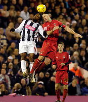 Photo: Leigh Quinnell.<br /> West Bromwich Albion v Coventry City. Coca Cola Championship. 16/12/2006. West Broms Nathan Ellington jumps with Coventrys Robert Page.