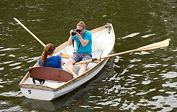 © Licensed to London News Pictures. 24/07/2013. Stratford upon Avon, Warwickshire, UK. As temperatures rise after the recent thunderstorms and rain, people flocked to Stratford upon Avon to start enjoying the sun. Pictured, picture perfect a couple boating on the river. Photo credit : Dave Warren/LNP