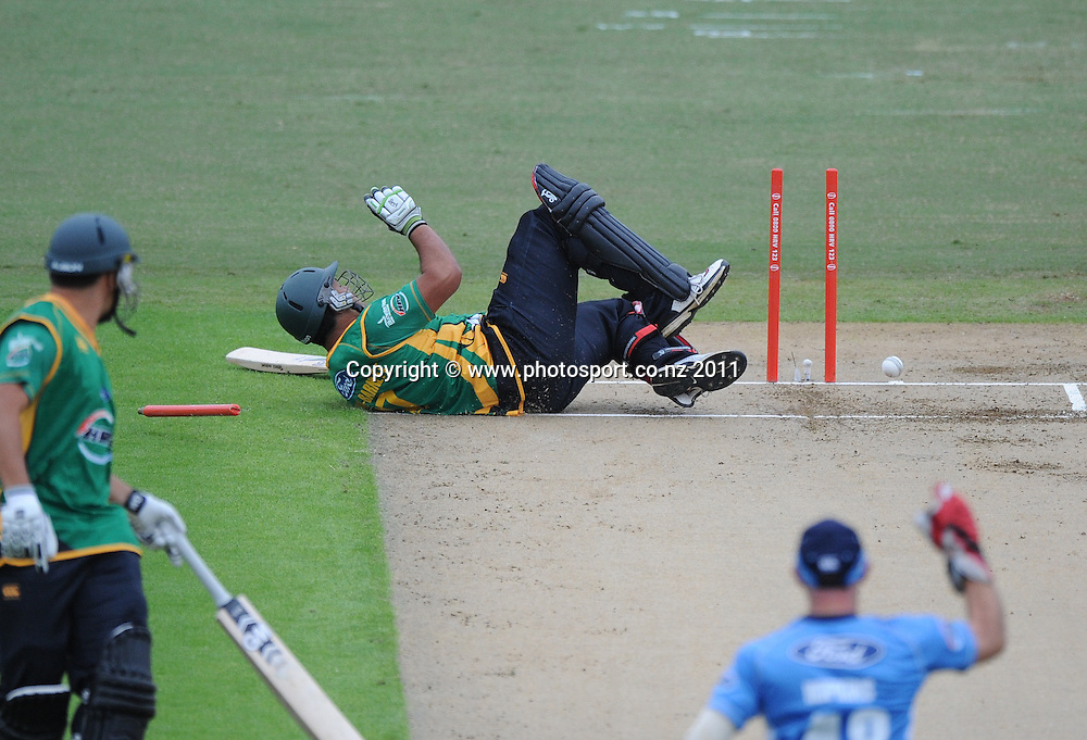 Central's Kieran Noema-Barnett is run out off a direct hit by Andre Adams during the HRV Twenty20 Cricket match between the Auckland Aces and Central Stags at Colin Maiden Oval in Auckland, New Zealand on Thursday 12 January 2012. Photo: Andrew Cornaga/Photosport.co.nz