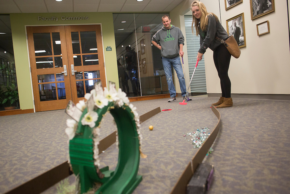 Hailey Effer, a freshman, right, plays miniature golf with her dad Brad Dew, of Cincinnati, in Alden Library during Dad's Weekend on November 5, 2016.