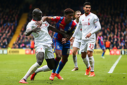 Wilfried Zaha of Crystal Palace holds back Mamadou Sakho of Liverpool - Mandatory byline: Jason Brown/JMP - 07966386802 - 06/03/2016 - FOOTBALL - London - Selhurst Park - Crystal Palace v Liverpool - Barclays Premier League
