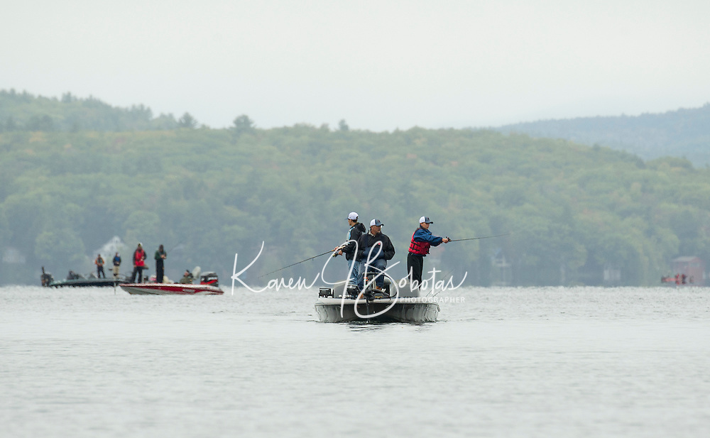 Boats seen from Bartlett Beach on Lake Winnisquam are filled with anglers during the NHIAA State Bass Fishing Tournament on Saturday.  (Karen Bobotas/for the Laconia Daily Sun)