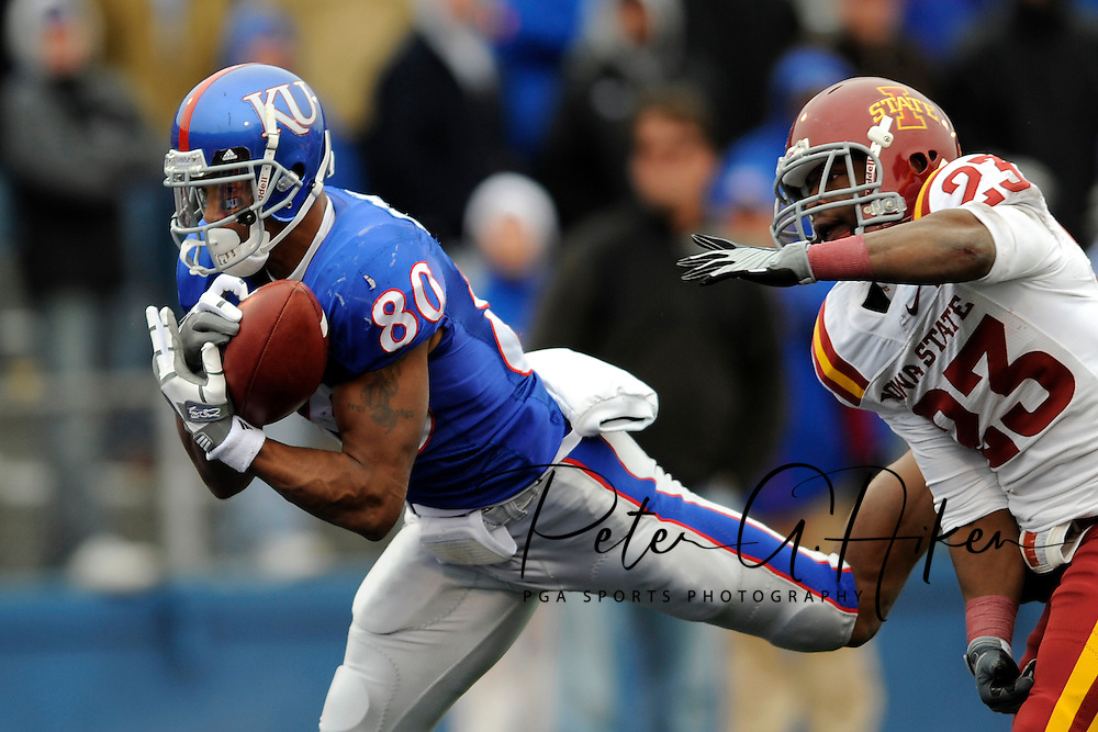 October 10, 2009: Wide receiver Dezmon Briscoe #80 of the Kansas Jayhawks catches a 46-yard touchdown pass against pressure from defensive back Leonard Johnson #23 of the Iowa State Cyclones during the fourth quarter at Memorial Stadium in Lawrence, Kansas.  Kansas defeated the Cyclones 41-36.