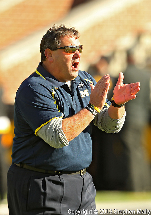 November 23 2013: Michigan Wolverines head coach Brady Hoke encourages his team as they warmup before the start of the NCAA football game between the Michigan Wolverines and the Iowa Hawkeyes at Kinnick Stadium in Iowa City, Iowa on November 23, 2013. Iowa defeated Michigan 24-21.
