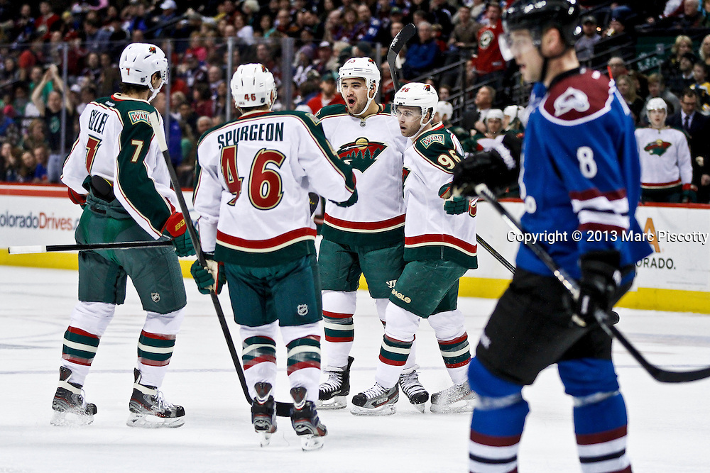 SHOT 3/16/13 1:22:01 PM - The Minnesota Wild's Devin Setoguchi #10 gets congratulations from teammates after scoring against the Colorado Avalanche during their regular season NHL game at the Pepsi Center in Denver, Co. The Minnesota Wild won the game 6-4. (Photo by Marc Piscotty / © 2013)