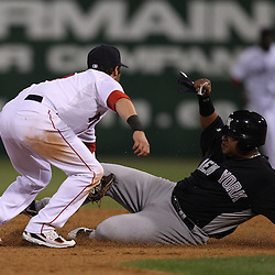 March 14, 2011; Fort Myers, FL, USA; Boston Red Sox second baseman Dustin Pedroia (15) tags out New York Yankees third baseman Ronnie Belliard (26) during a spring training exhibition game at City of Palms Park.   Mandatory Credit: Derick E. Hingle