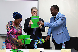 August 10, 2017 - Dar es Salaam, Tanzania - Philanthropist Bill Gates announced a 5 million investment to help digitize Tanzania's health information systems and improve health data in the country. Gates congratulated members of the government of Tanzania on leading a drive to incorporate digital health and data into their policy framework. Pictured: Dr. Ummy Mwalimu, Minister of Health (left), and the honorable George Simbachawene, Minister of President's Office, giving Gates a document denoting the initiative's launch. (Credit Image: © Ric Francis via ZUMA Wire)