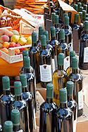 Bottles of wine and fruit, Chianti Grape Harvest Festival in Impruneta, Italy