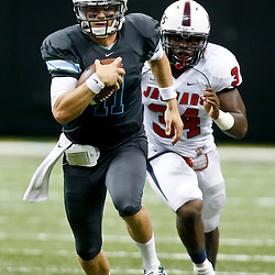 Sep 7, 2013; New Orleans, LA, USA; Tulane Green Wave quarterback Nick Montana (11) runs from South Alabama Jaguars inside linebacker Desmond LaVelle (34) during the second half of a game at the Mercedes-Benz Superdome. South Alabama defeated Tulane 41-39. Mandatory Credit: Derick E. Hingle-USA TODAY Sports