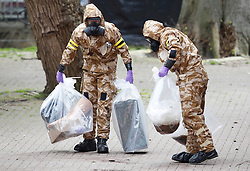 © Licensed to London News Pictures. 24/04/2018. Salisbury, UK. Members of the armed forces remove contaminated material in the area at the Maltings where a bench was earlier removed as the cleanup operation begins in Salisbury. Former Russian Spy Sergei Skripal and his daughter Yulia were poisoned using a nerve agent in the city last month. Experts have warned that 'Toxic levels' of the nerve agent novichok could still be present at hot spots around the city. Photo credit: Peter Macdiarmid/LNP