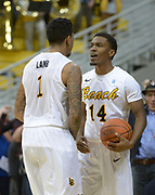 Dec 19, 2013; Long Beach, CA, USA; Long Beach State guards Tyler Lamb (1) and Branford Jones (14) react during the game against the Southern California Trojans at Walter Pyramid. Long Beach State defeated USC 72-71.