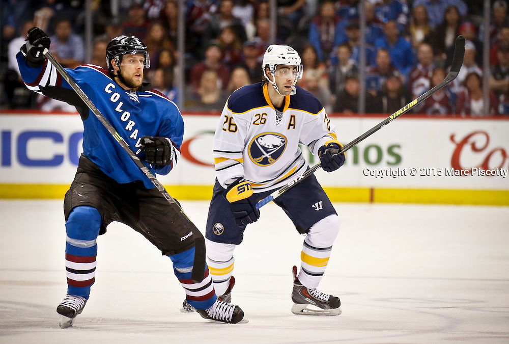 SHOT 3/28/15 9:26:13 PM - The Colorado Avalanche's Jan Hejda #8 and the Buffalo Sabres' Matt Moulson #26 watch the action during their regular season NHL game at the Pepsi Center in Denver, Co. The Avalanche won the game 5-3. (Photo by Marc Piscotty / © 2015)