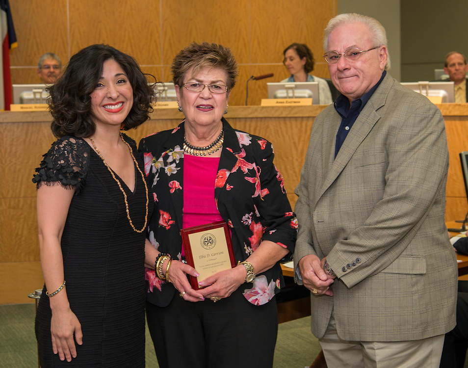 Juliet Stipeche and Elba Carrion pose for a photograph during the Houston ISD Board of Trustees meeting, May 14, 2015.