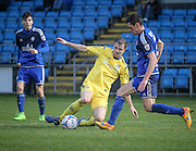 James Bolton (Halifax) and Adam Boyes (Guiseley) challenge for the ball during the Conference Premier League match between FC Halifax Town and Guiseley at the Shay, Halifax, United Kingdom on 5 December 2015. Photo by Mark P Doherty.