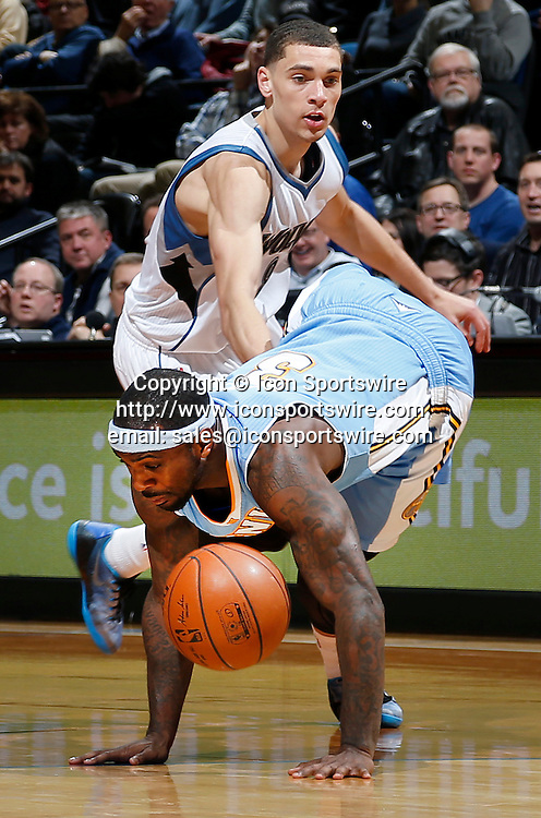 Jan. 5, 2015 - Minneapolis, MN, USA - Minnesota Timberwolves' Zach LaVine (8) fouls Denver Nuggets' Ty Lawson (3) during the third quarter on Monday, Jan. 5, 2015, at the Target Center in Minneapolis