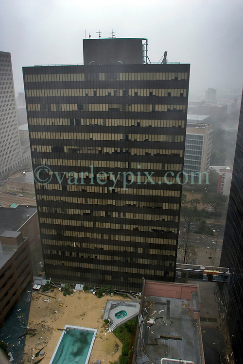 29 August, 2005. New Orleans, Louisiana.<br /> Hurricane Katrina hits New Orleans. Glass tumbles from the Hyatt hotel as the storm slams the region.<br /> Photo; Charlie Varley.