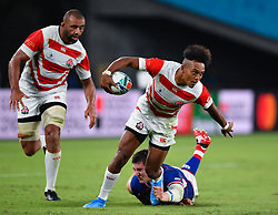 Japan's Kotaro Matsushima evades the tackle of Russia's Nikita Vavilin during the Pool A match between Japan and Russia at the Tokyo Stadium, Tokyo, Japan. Picture date: Friday September 20, 2019. See PA story RUGBYU Japan. Photo credit should read: Ashley Western/PA Wire. RESTRICTIONS: Editorial use only. Strictly no commercial use or association. Still image use only. Use implies acceptance of RWC 2019 T&Cs (in particular Section 5 of RWC 2019 T&Cs) at: https://bit.ly/2knOId6