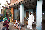 Sidi community members socialise in courtyard in a small community in central Ahmedabad exclusively occupied by Sidi families. It surrounds a Bava Gor shrine, the sidi patron saint for Muslim Sidi's, and the local side's are tasked with looking after the shrine