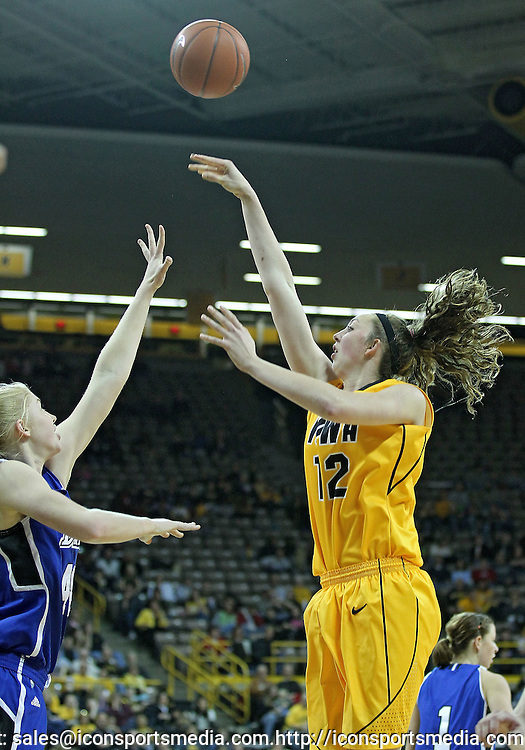 December 20, 2011: Iowa Hawkeyes center Morgan Johnson (12) puts up a shot over Drake Bulldogs forward/center Stephanie Running (44) during the NCAA women's basketball game between the Drake Bulldogs and the Iowa Hawkeyes at Carver-Hawkeye Arena in Iowa City, Iowa on Tuesday, December 20, 2011. Iowa defeated Drake 71-46.