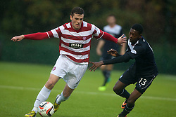 Hamilton's Michael Devlin and Falkirk's Rakish Bingham.<br /> Hamilton 2 v 0 Falkirk, Scottish Championship played today at New Douglas Park.<br /> &copy;Michael Schofield.