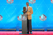 Aug 3, 2019; Canton, OH, USA; Tony Gonzalez poses with bust during the Pro Football Hall of Fame Enshrinement at Tom Benson Hall of Fame Stadium. (Robin Alam/Image of Sport)