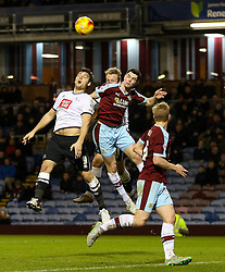 Chris Martin of Derby County challenges Burnley's Michael Keane - Mandatory byline: Matt McNulty/JMP - 25/01/2016 - FOOTBALL - Turf Moor - Burnley, England - Burnley v Derby County - Sky Bet Championship