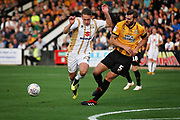 MKDons defender Callum Brittain (25) is fouled on the edge of the box by Cambridge United's Greg Taylor(5) during the EFL Sky Bet League 2 match between Cambridge United and Milton Keynes Dons at the Cambs Glass Stadium, Cambridge, England on 13 October 2018.