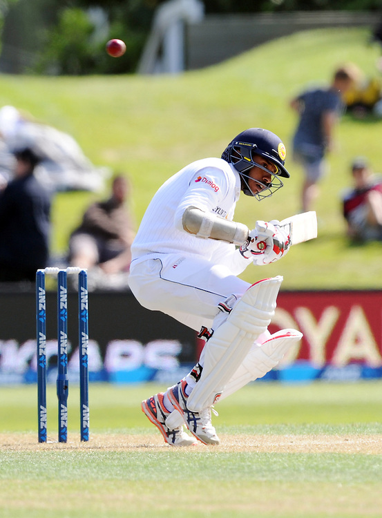Sri Lanka's Kithuruwan Vithanage ducks a bouncer from New Zealand's Tim Southee on day two of the first International Cricket Test, University Cricket Oval, Dunedin, New Zealand, Friday, December 11, 2015. Credit:SNPA / Ross Setford