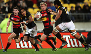 Canterbury's Andy Ellis tries to fend off Victor Vito as Colin Slade (left) and Ma'a Nonu look on.<br /> Air NZ Cup Ranfurly Shield match - Wellington Lions v Canterbury at Westpac Stadium, Wellington, New Zealand. Saturday, 29 August 2009. Photo: Dave Lintott/PHOTOSPORT