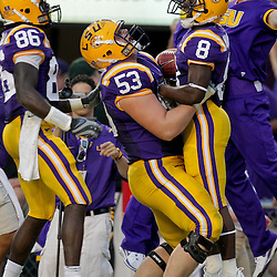 19 September 2009: LSU Tigers running back Trindon Holliday (8) celebrates with teammates T-Bob Hebert (53) and Chris Mitchell (86) after a score during a game between the University of Louisiana Lafayette Ragin' Cajuns and the  LSU Tigers at Tiger Stadium in Baton Rouge, Louisiana.