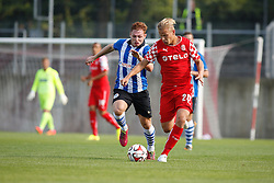 26.07.2014, Paul-Janes-Stadion, Duesseldorf, GER, FS Vorbereitung, Testspiel, Fortuna Duesseldorf vs Wigan Athletic, im Bild Sommer-Neuzugang Joel Pohjanpalo (Fortuna Duesseldorf #20) im Zweikampf gegen Ivan Ramis (Wigan Athletic #21) // during a Friendly Match between Fortuna Duesseldorf and Wigan Athletic at the Paul-Janes-Stadion in Duesseldorf, Germany on 2014/07/26. EXPA Pictures © 2014, PhotoCredit: EXPA/ Eibner-Pressefoto/ Schueler<br /> <br /> *****ATTENTION - OUT of GER*****
