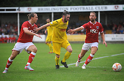 Luke Freeman of Bristol City and Scott Wagstaff jostle for the ball against Brislington's Liam Knight - Photo mandatory by-line: Dougie Allward/JMP - Mobile: 07966 386802 - 05/07/2015 - SPORT - Football - Bristol - Brislington Stadium - Pre-Season Friendly