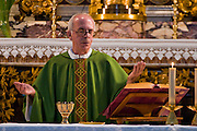 Riccardo Casagrande, a monk brother priest, leads a morning mass at the San Marcello al Corso Church in Rome, Italy, near the Spanish Steps. Casagrande is in charge of the kitchen, garden, and wine cellar for the brotherhood. (Riccardo Casagrande is featured in the book What I Eat: Around the World in 80 Diets.) MODEL RELEASED.