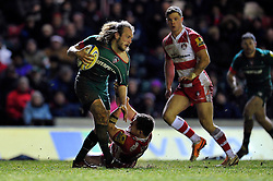 Sam Harrison of Leicester Tigers is tackled by Darren Dawidiuk of Gloucester Rugby - Photo mandatory by-line: Patrick Khachfe/JMP - Mobile: 07966 386802 13/02/2015 - SPORT - RUGBY UNION - Leicester - Welford Road - Leicester Tigers v Gloucester Rugby - Aviva Premiership