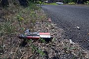 plastic gun laying along the road