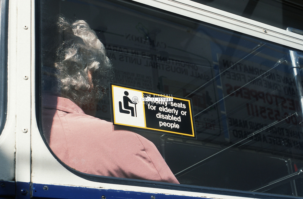 Public notice in window of bus informing passengers about reserved seating for elderly people or people with disabilities,