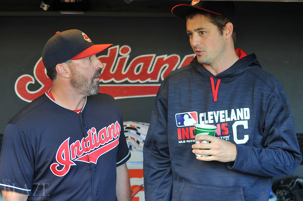 Aug 1, 2016; Cleveland, OH, USA; Cleveland Indians relief pitcher Andrew Miller (24) talks with pitching coach Mickey Callaway (32) before the game between the Cleveland Indians and the Minnesota Twins at Progressive Field. Mandatory Credit: Ken Blaze-USA TODAY Sports
