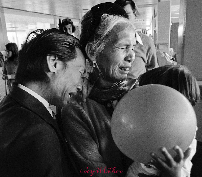 Families of Vietnamese refugees are reunited at Denver's Stapleton Field airport.  They were some of the first to resettle in the United Stares.  1974.