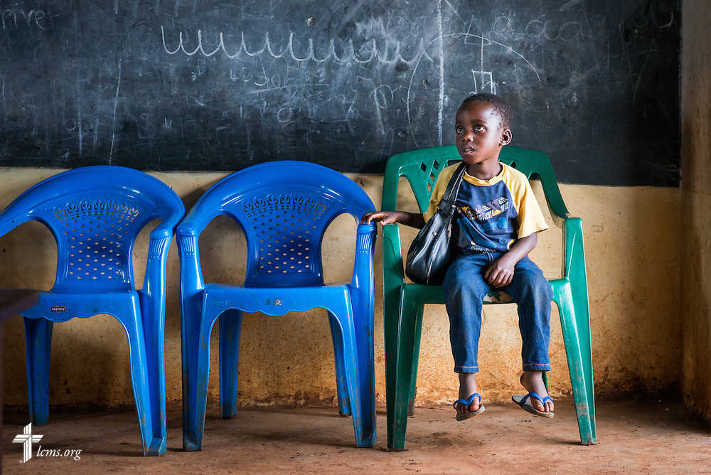 A child waits to receive care at the Mercy Medical Team clinic Tuesday, June 10, 2014, at the Luanda Doho Primary School in Kakmega County, Kenya. LCMS Communications/Erik M. Lunsford