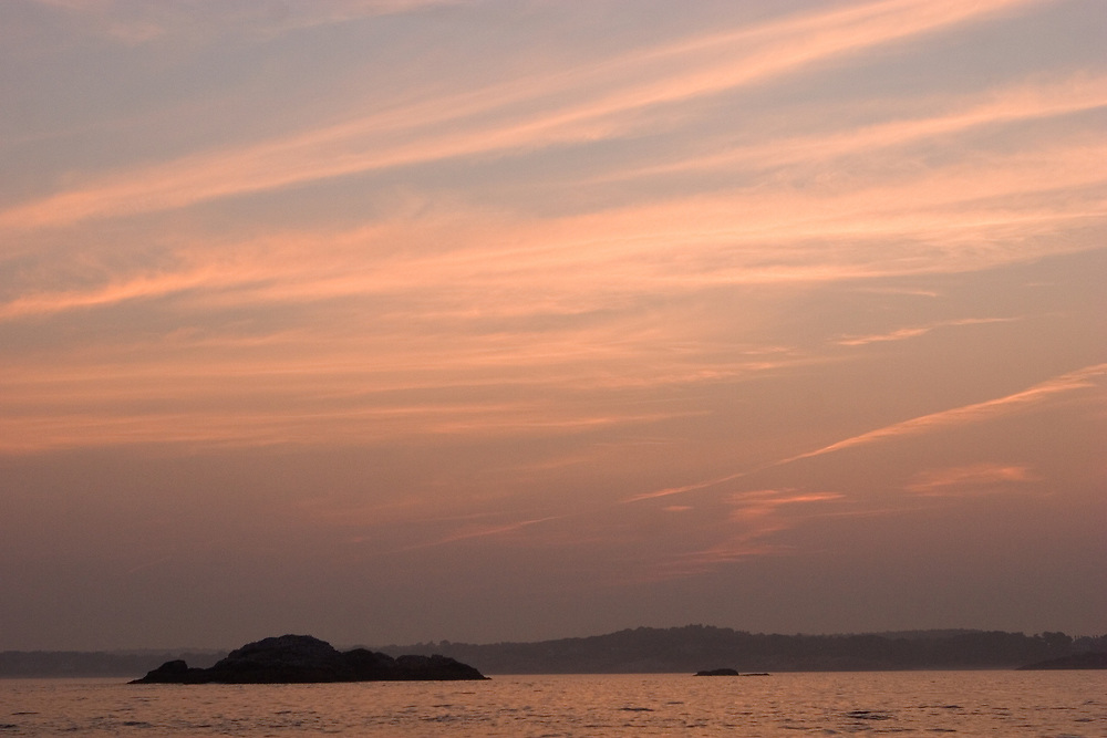 A sunset over egg rock in ipswitch bay.