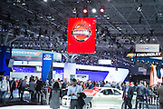 New York, NY, USA-23 March 2016. The Jacob Javits Center was crowded with vehicles, the press, industry insiders, and manufacturers' signage at the press and trade pre-opening of the New York Auto Show.
