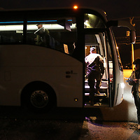 Soldiers from the 155th Headquarters Headquarters Company begin to board one of two buses in the early morning hours Tuesday from their facility in Tupelo as they leave for Fort Bliss for training before they deploy to the Middle East.