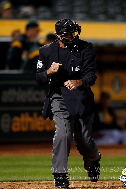 OAKLAND, CA - APRIL 04:  MLB umpire Angel Hernandez #55 calls a third strike during the eighth inning between the Oakland Athletics and the Los Angeles Angels of Anaheim at the Oakland Coliseum on April 4, 2017 in Oakland, California. The Los Angeles Angels of Anaheim defeated the Oakland Athletics 7-6. (Photo by Jason O. Watson/Getty Images) *** Local Caption *** Angel Hernandez