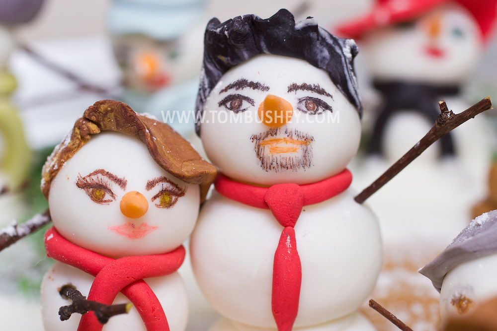 Middletown, New York - Tiny snowmen represent the owners of  Something Sweet Dessert Cafe on  Nov. 23, 2014. ©Tom Bushey / The Image Works