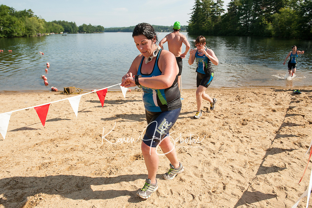 Julie Sforza and Celeste Craig exit the water during their first lap of the Steeplechase 5K held at Opechee Park on Sunday morning.  (Karen Bobotas/for the Laconia Daily Sun)